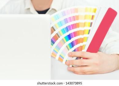 Graphic design, printing, advertising Graphic designer with pantone palette