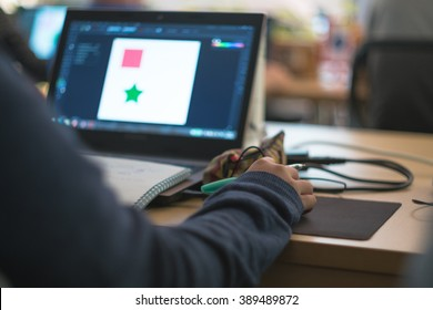 graphic design student learning in the classroom