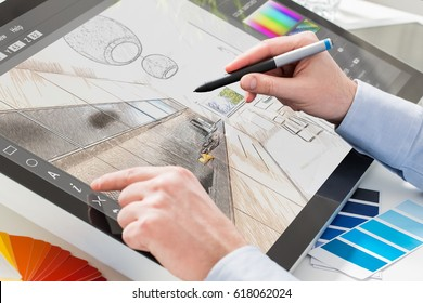 Graphic Designer designs and sketches on the tablet or touch screen the interior of the apartment (bathroom).