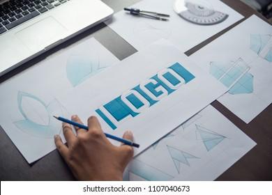 Graphic designer development process creative design sketch drawing logo Trademark brand Workspace