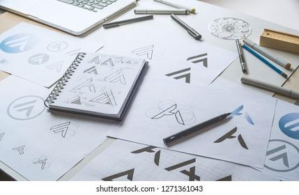 Graphic designer drawing sketch design creative Ideas draft Logo product trademark label brand artwork. Graphic designer studio Concept. - Shutterstock ID 1271361043