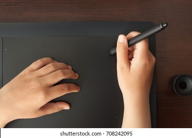 Graphic designer draws on a tablet. Business concept