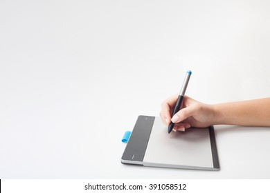 graphic designer hands writing on digital tablet with copy space for graphic design or website