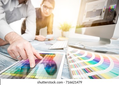 Graphic designer at work. Color swatch samples. - Shutterstock ID 716621479