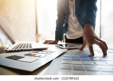 Graphic designer working with Color swatch samples.