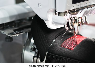 Graphic embroidery machine on the hat