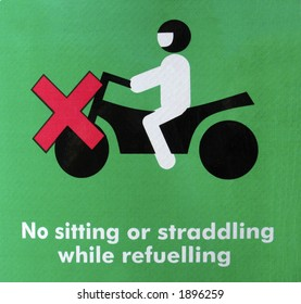 graphic sign warning to get off your motorcycle to fuel