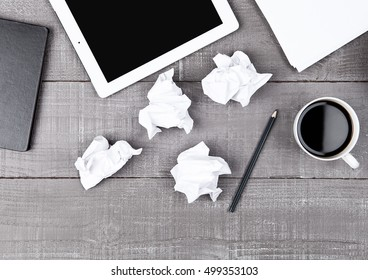 Graphic tablet with paper coffee cup and pencil on office desk