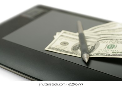 Graphic tablet with pen and money close up shoot, selective focus