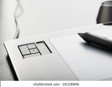 Graphic tablet with pen on table