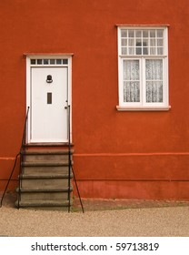Graphical image of a facade with door and window with a mediterranean touch