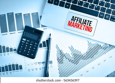 Graphs, charts and keyboard with text AFFILIATE MARKETING