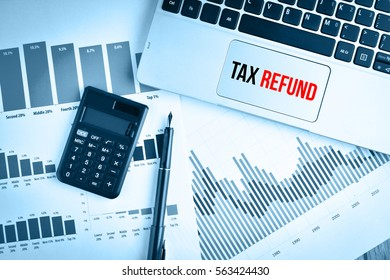 Graphs, charts and keyboard with text TAX REFUND