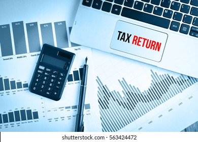 Graphs, charts and keyboard with text TAX RETURN
