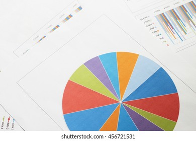 Graphs and charts on business table. The workplace of business people.