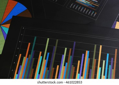 Graphs and charts. The workplace of business people.