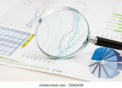 Graphs tables and documents laid on the table