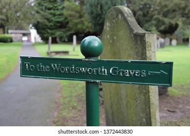 Grasmere, Cumbria, England: December 2018 - The Wordsworth grave signpost in Grasmere village in the Lake District.