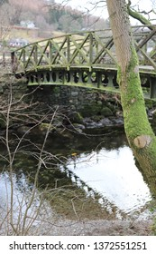 Grasmere, Cumbria, England: December 2018 - A old wooden bridge and river in the village of Grasmere in the Lake District, England.