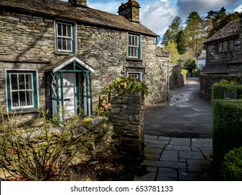 Grasmere, Cumbria, England. Traditional slate brick cottages in the rural English Lake District town of Grasmere known as the home of poet Willam Wordsworth.