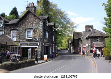 GRASMERE, THE LAKE DISTRICT, CUMBRIA, UK : 17 August 2016 : Pedestrians outside the gift shop and cafe in the Main Street in the centre of Grasmere Village