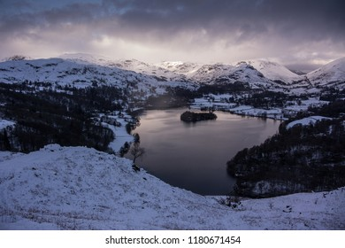 Grasmere from Loughrigg Fell, English Lake District. Winter evening at dusk with full snow cover