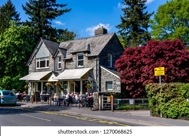 Grasmere, United Kingdom - April 29, 2011: Tourists at a restaurant in the village of Grasmere in the Cumbria lakes district in England.