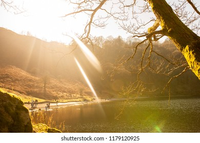 Grasmere/England - February 25th 2018: Grasmere lakeside on sunny afternoon with camera lens flare