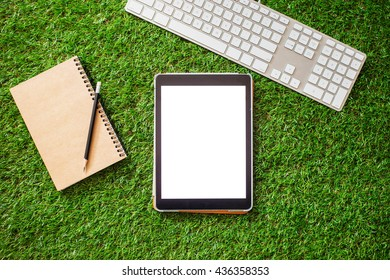 Grass background with office supplies, top view.blank space for adjustment.