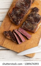 Grass Fed Juicy Steak Sliced on Wooden Board
