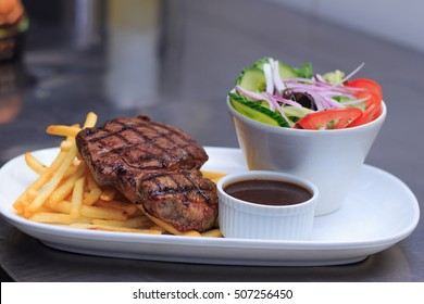Grass Fed Rump Steak with Salad, Chips and pepper sauce is ready to serve at australian pub bistro, restaurant