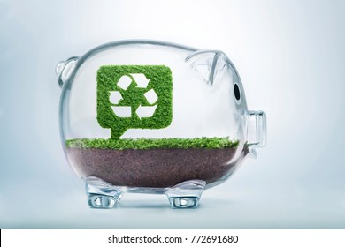 Grass growing in the shape of a bubble talk with a cut out recycle sign, inside a transparent piggy bank, symbolising the need to invest in the protection of the environment.