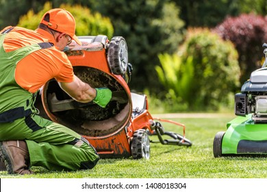 Grass Mower Problem. Caucasian Gardener Looking Under the Machine. Technical Issue.