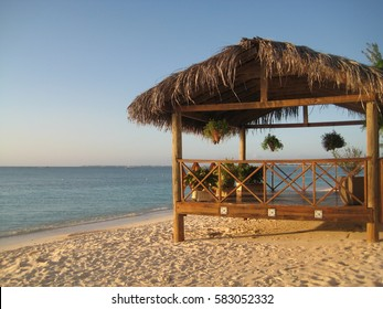 Grass roofed cabana on sand beach