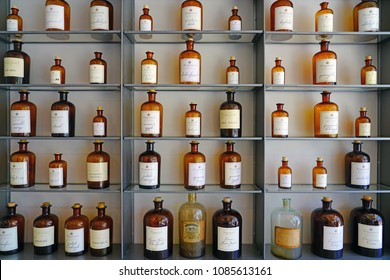 GRASSE, FRANCE -21 APR 2018- Bottles of perfume essences used to compose perfumes at the Musee du Parfum Fragonard museum in Grasse. Some bottles are organised in the shape of a musical organ.