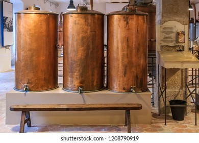Grasse, France - October 18, 2013:  Antique copper distiller for perfume production in the famous Fragonard factory in Grasse, world perfume capital