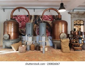 GRASSE, FRANCE - OCTOBER 31, 2014: Ancient distiller for the production of perfume in Fragonard factory