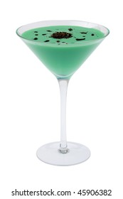 Grasshopper mixed drink with shaved chocolate garnish on white background