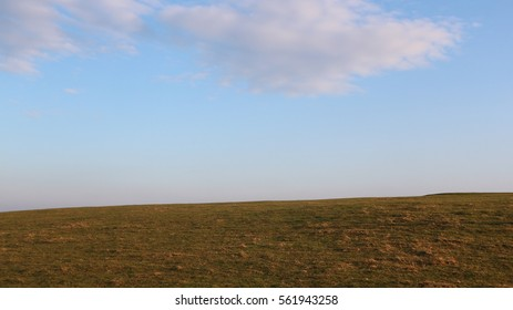 Grassland with sky and clouds on sunny day on Cleeve Hill, Gloucestershire, England, UK