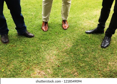 Grassroots democracy concept image consisting of 3 politicians having a meeting outside on a lawn.