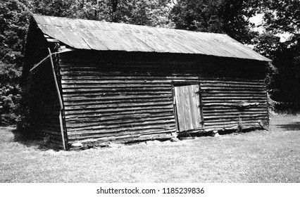 Grassy Creek, North Carolina - May 16, 1998: An old tobacco barn on a farm in Grassy Creek, North Carolina, May 16, 1998.