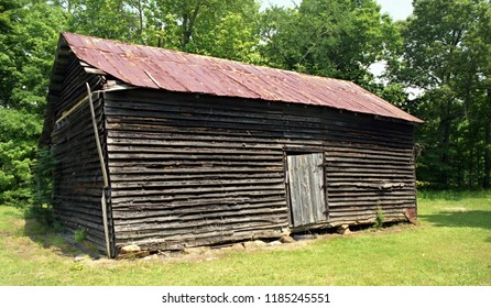 Grassy Creek, North Carolina / USA - May 16, 1998: An old tobacco barn on a farm in Grassy Creek, North Carolina, May 16, 1998.
