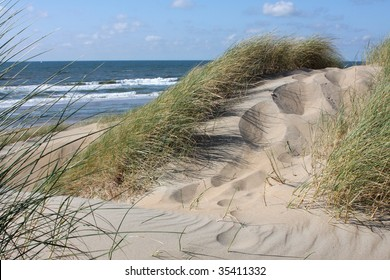 "Grassy dune with the ocean in the background. Near Scheveningen in Holland. (sand dunes are also called ""Dutch mountains"")"