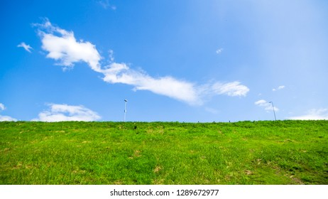 The grassy hills with the sky behind