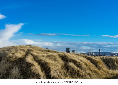 Grassy sand dunes at the South Gare. Located on the north east coast of England.