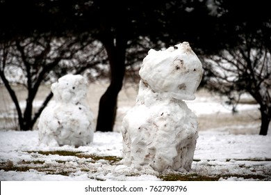 Grassy snowman.  or Angry young snowman and the sweetheart who watch it behind anxiously.