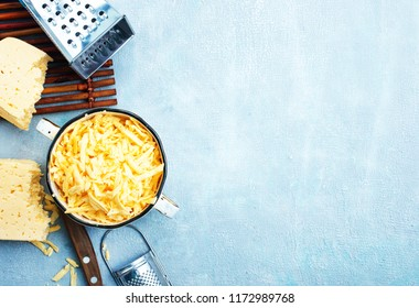 Grated cheese in brown bowl. Grated cheese.