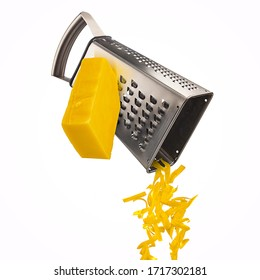 Grated cheese falling from metal grater isolated on white background