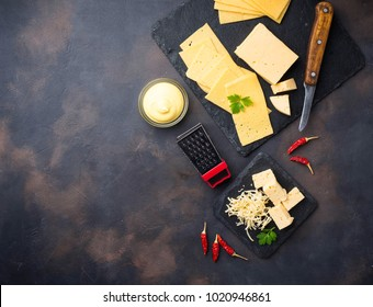 Grated cheese on slate board. Top View