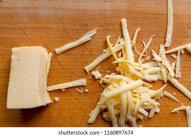 grated cheese on a wooden board